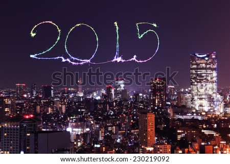 2015 New Year Fireworks celebrating over Tokyo cityscape at night, Japan