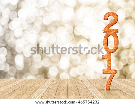 2017 new year glitter number in perspective room with sparkling bokeh wall and wooden plank floor #465754232
