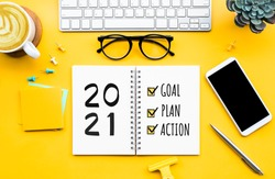 2021 new year goal,plan,action concepts with text on notepad and office accessories.Business management,Inspiration to success ideas