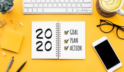 2020 new year goal,plan,action text on notepad with office accessories.Business motivation,inspiration concepts ideas