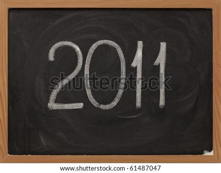 2011 new year handwritten with white chalk on blackboard #61487047