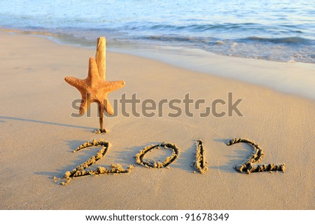2012 new year message on the sand beach with starfish