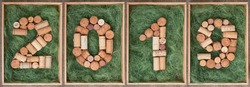 2019 New year numbers made of wine corks on green background in wooden box