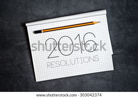 2016, New Year Resolutions Concept with Pencil and Notebook for Writing Goals and Aspiration in Following Year