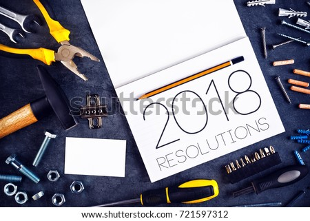 2018, New Year Resolutions Craftsman Workshop Concept with Assorted Tools, Pencil and Notebook for Writing Goals and Aspiration in Following Year