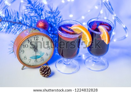 New Year's Fletley 2019 year of the pig. clock with a time of five to eight on a white background with blue bokeh and mulled wine