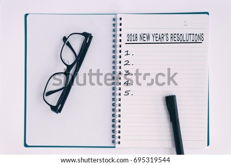 2018 new year's resolutions list on notepad. Retro style and analog treatment.