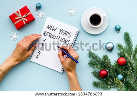 2021 New Year's resolutions with Christmas decorations. Overhead view