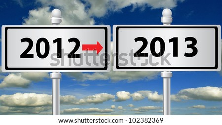 2012 - 2013 ,new year signpost on sky background