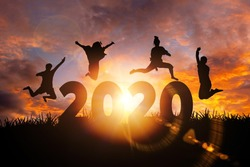 2020 New Year silhouette of woman jumping during golden sunrise or sunset with copy space. Image for Happy new year 2020 concept.