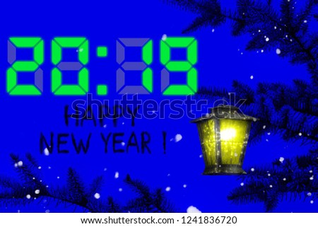 2019 New Year timer. Vintage colorful lantern hangs on a Christmas tree against the dark blue night sky. Magical lighting with sparkles. It's snowing. Congratulations words Happy New Year in English #1241836720