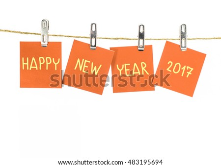 2017 new year. word hanging on the Notes paper cards in clothes pegs on rope with isolate