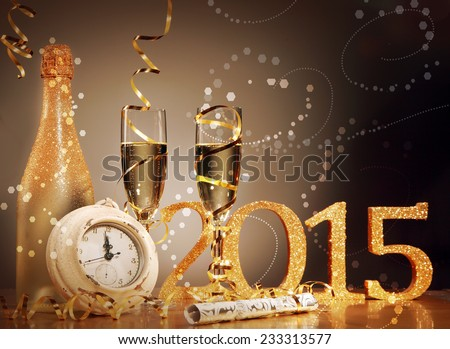 2015 New Years Eve celebration background with an elegant arrangement with a clock counting down to midnight, flutes and bottle of champage and party streamers with a cracker, bubble bokeh