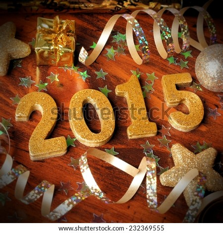 2015 New Years Eve golden numbers with confetti and decorations on wooden background       #232369555