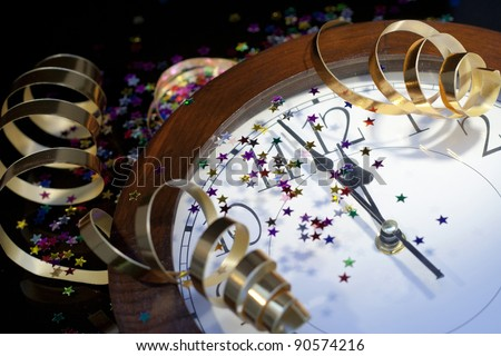 2012 New Years Party Background. Clock and festive tinsels