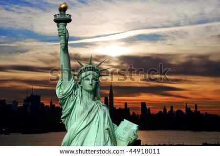 new york early sunrise cityscape skyline silhouette, usa. statue of liberty over hudson river. nyc city skyline.