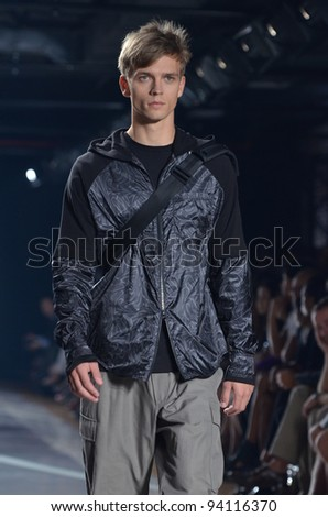 NEW YORK, NY - SEPTEMBER 11: A model walks the runway at the Y-3 Spring 2012 fashion show during Mercedes-Benz Fashion Week at 82 Mercer on September 11, 2011 in New York City