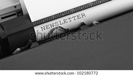"""newsletter"" message typed by vintage typewriter."