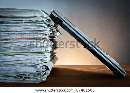 ,newspaper,document and laptop,