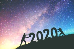 2020 Newyear  Couple tries to push number of 2020 Happy new year background on  the Milky Way galaxy
