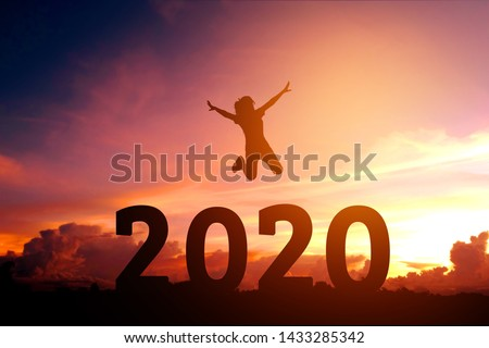2020 Newyear Silhouette young woman jumping to Happy new year concept.
