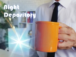 Night Depository sign. Man with a cup of coffee in the background.