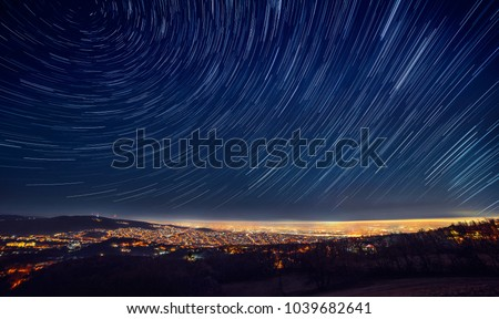 Night sky star trail over the city #1039682641