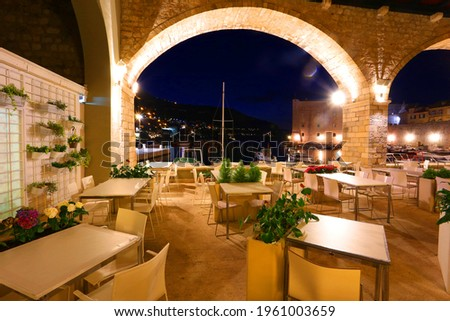 night view in Dubrovnik sity, wonderful croatian scene, tables and chair for tourists on background night bay and bastion, Europe, Croatia, Dalmatia Stock photo ©