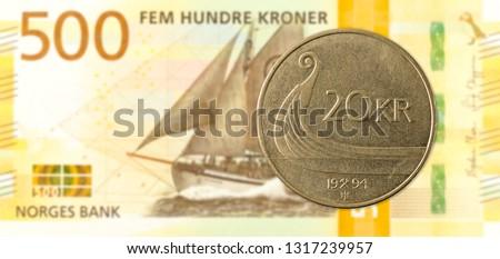 20 norwegian krone coin against 500 new norwegian krone banknote #1317239957