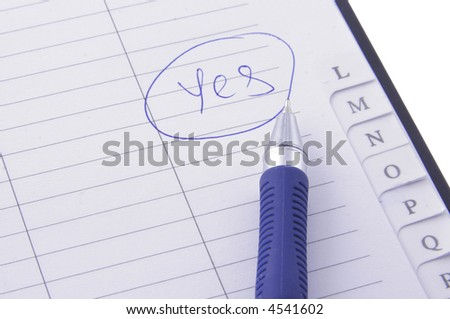 notebook with a ball pen