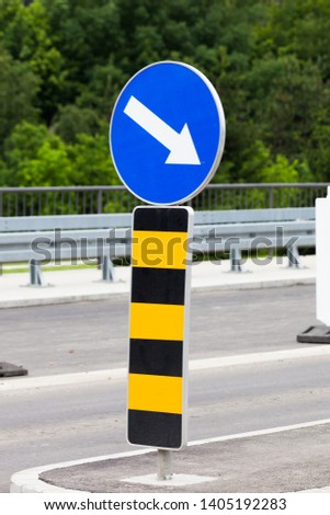 notification sign  changes direction of movement due to works on road  #1405192283