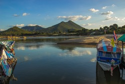16 November 2019: Mekong river boat docked at the pier The mountain view of Laos, viewed from Kaeng Khud Khu, is a popular tourist destination in Loei Province, Thailand.