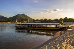 16 November 2019: Reduced water conditions of the Mekong River at the pier with beautiful mountain views in the evening, a popular tourist destination in Loei province.