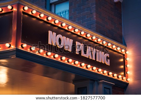 'Now Playing' Vintage Marquee Bulbs light sign. ストックフォト ©