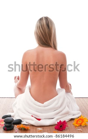 stock photo : Nude women sitting in spa with towel around her waist