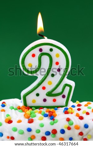 Number Two Birthday Candle On Green Background 46317664