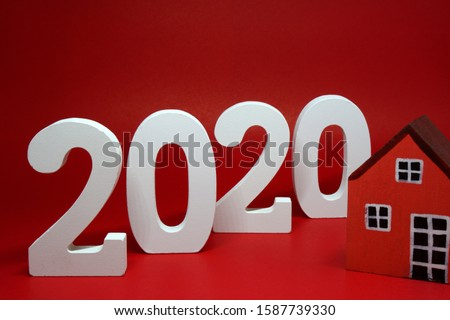 2020 number wooden figures with House figures object on red background - Happy new year 2020 , Chinese new year - red concept - home building trends