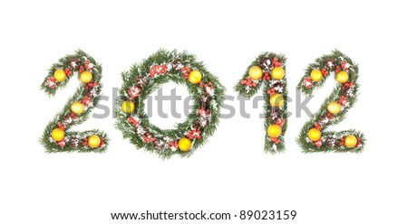 2012 number written by christmas tree branches isolated on a white background