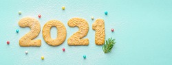 2021 numeral made of gingerbread christmas cookies with sugar powder. New year concept. Food numbers. 2021 logo. Creative design. Top view. Mint paper background. Copy space. Place for text.