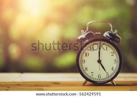 5 o'clock retro clock vintage color tone in the garden Сток-фото ©