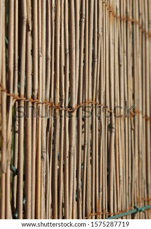 [object Object] A fence of thin rods brown