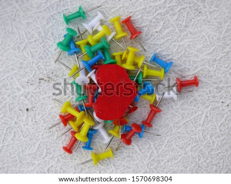 [object Object]Abstract ideas with colored pins in the shape of a heart and an apple. #1570698304
