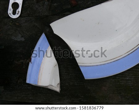 [object Object]Abstract image of a chopped plate with a blue border. Geometric fragments of ceramics for backgrounds and design.