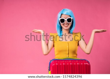 [object Object]Asian pretty young woman walking over pink  pastel background. She smiling and  holding shopping bags. she nice-looking lovely attractive shine .