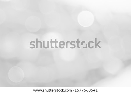[object Object]Gray and white nature blurred color glow colorful light sparkling summer. Valentine's day blurry concept. Abstract white bokeh texture with soft foreground bubble shiny in grey vintage