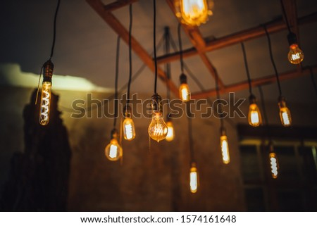 [object Object]View on hanging vintage light bulbs, Edison style light