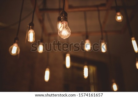 [object Object]View on hanging vintage light bulbs, Edison style light  #1574161657