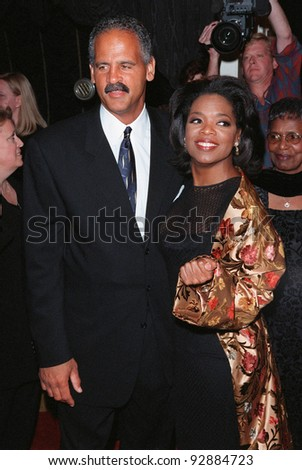 """12OCT98:  TV chat show queen OPRAH WINFREY & fiance STEADMAN GRAHAME at the Los Angeles premiere of her new movie """"Beloved."""""""