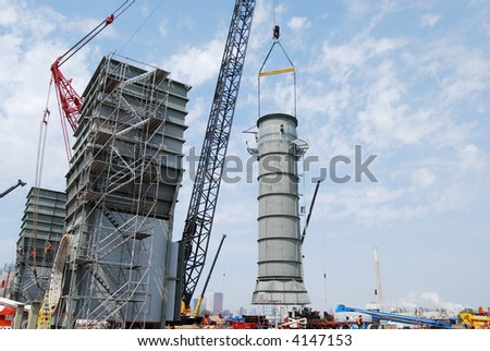 4 of 4-Industrial construction site-crane lifting smoke stack