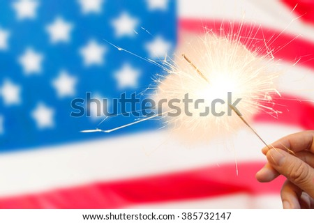 4 of july concept with sparkler and usa flag #385732147